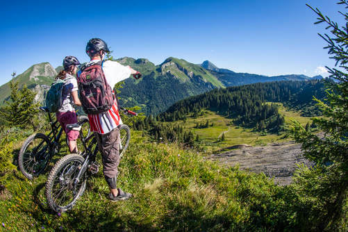 image of mountain bikers enjoying a view in Morzine mountains