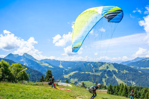image of a man paragliding in Morzine