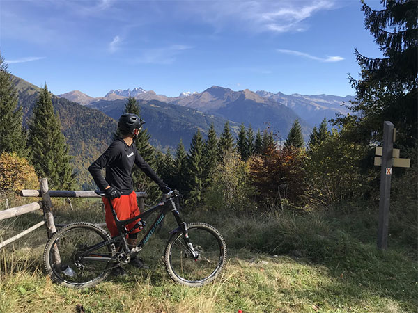 Image of a Morzine mountain biker on hilltop with view