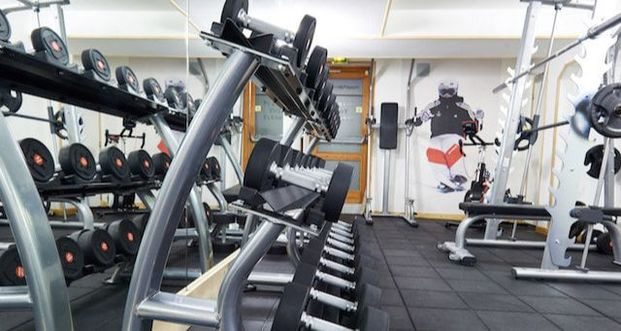Image of gym equipment and weights at Aiglon Morzine fitness center