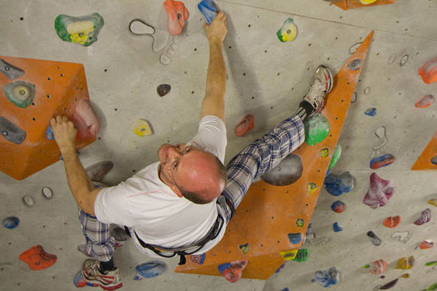 Image of a man climbing indoor rock climbing in Morzine