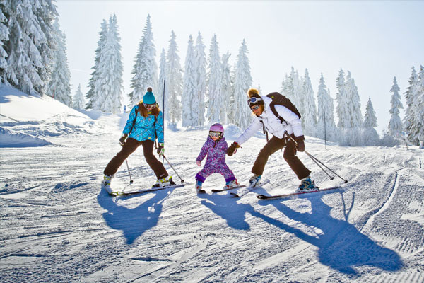 Image of a kid and parents skiing at Morzine