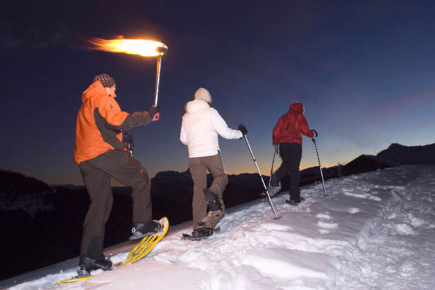 Image of Morzine night time snow shoe trekkers