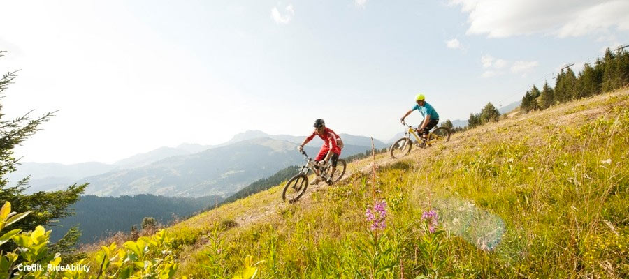 Image of 2 men cycling a high mountain trail at Morzine