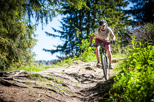 Image of a woman enjoying a bike trail in Morzine
