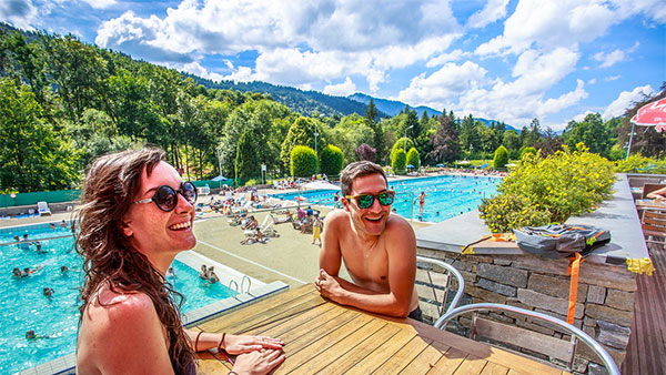 Image of a happy couple by pool in Portes du Soleil near Morzine