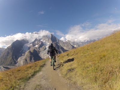 Image of a man biking in the Morzine mountains in summer