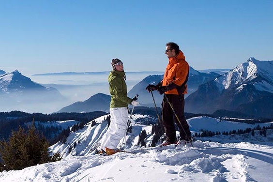 Image of a happy skiiing couple on a Morzine winter mountain top